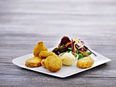 Chicken nuggets with mayonnaise and salad