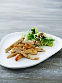 Chicken strips with a mixed leaf salad