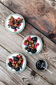 Yogurt with summer berries, date syrup and crispy rye bread