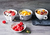 Berry muesli, amaranth muesli with mango and quark muesli with physalis