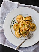 Pumpkin ravioli with pecan nut butter and sage