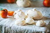 Meringue with apricots on a table