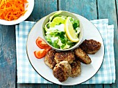 Meat patties with a carrot and cabbage salad