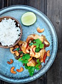 Chicken with cashew nuts and limes served with rice