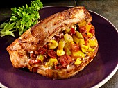 A pork chop stuffed with sweetcorn and tomatoes