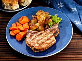 Pork chop with carrots and fried potatoes