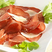 Bresaola (air-dried Italian beef) with Parmesan shavings, rocket and olive oil