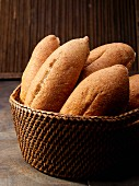 Mexican bolillo rolls in a wicker basket