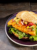 Grilled spicy chicken breast sandwich with mango and pineapple salsa