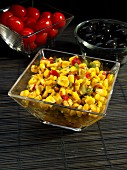 Spicy corn salad in glass bowl