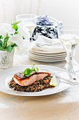 Crispy fried salmon on a lentil medley