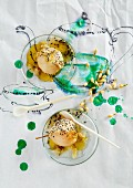 Pears poached in jasmine tea with coconut and black sesame seeds