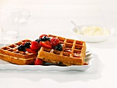 Fresh waffles with berry salad