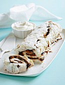 Meringue roll filled with chocolate and caramel sauce