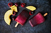 Cherry and pineapple ice lollies