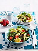 Mixed summer salad with strawberries, mango and avocado