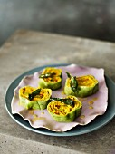 Spinach pasta rolls with a pumpkin and ricotta filling and sage butter