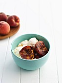 Vanilla ice cream with grilled peaches