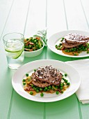 Minute steaks with pepper, peas and bacon
