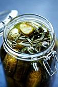 A jar of gherkins with tarragon