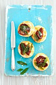 Puff pastry tartlets with dried tomatoes and sage