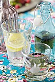 Homemade lemonade with herbs and lemons