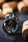 A corkscrew and corks