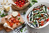 Sardine bake with potatoes, garlic, cherry tomatoes and parsley