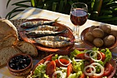 Grilled sardines with salad and potatoes