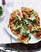 A wholemeal pizza with herbs, vegetables and grated Parmesan