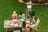 Friends eating together outdoors