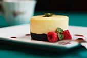 Raspberry cheesecake with raspberries and mint