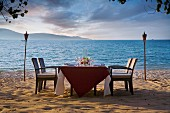 A table on a beach in Malaysia laid for dinner