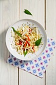 Savoury millet salad with white cabbage and strips of pepper