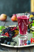A berry smoothie made with redcurrants and blueberries