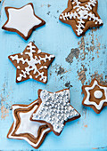 Gingerbread stars decorated with icing sugar and silver pearls