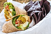 Falafel wraps served with tortilla crisps