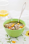 Chicken meatball soup with vegetables and fish-shaped crackers