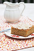 A slice of carrot cake with apples, courgettes and cider frosting