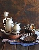 Old baking tins, metal jugs and silver cutlery
