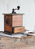 An antique wooden coffee mill