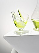 A cucumber cocktail with ice cubes
