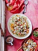 White cabbage salad with carrots, feta cheese and sesame seeds