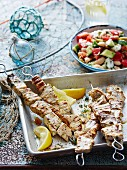 Swordfish souvlaki skewers with vegetable salad