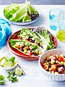 Spicy kidney bean and corn salad with avocado and peppers served in cos lettuce leaves