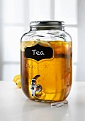 Lemon tea in a jar with a tap
