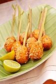 Fried prawn balls on lemongrass sticks with sesame seeds and lines