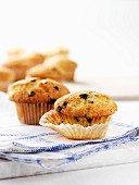 Blueberry muffins on a tea towel