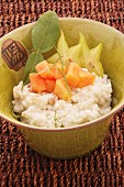 Thai coconut rice pudding with papaya and star fruits