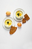Oeufs en cocotte with spring herbs (France)